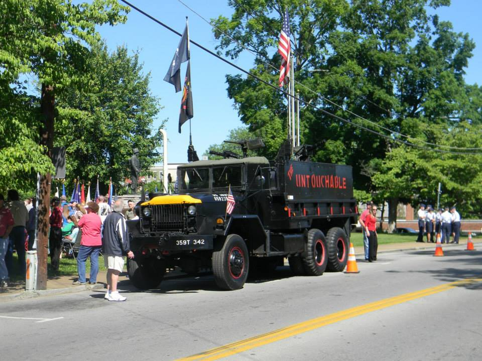 Image from front of black tank-like truck with The Untouchables in red writing on side